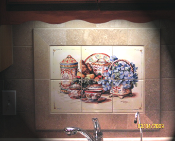 A nice big border around this small tile mural really sets the tile mural  off in this kitchen backsplash off!