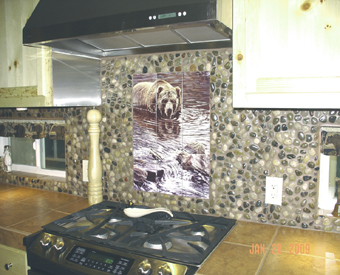Check out this AWESOME rustic kitchen backsplash. This client incorporated river rock in with their bear tile mural. A+ for imagination and creativity!!