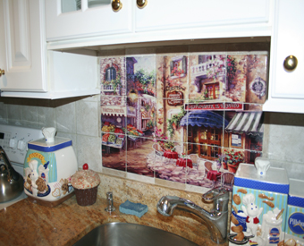 The beautiful colors of Karen Stene's restaurant scent tile mural compliment  the colors used in this kitchen. This colorful tile mural adds