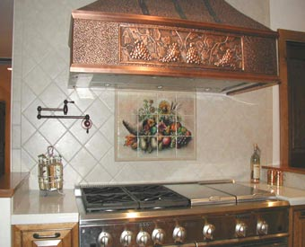 The different shades on this cornucopia tile mural really go well with this tile mural backsplash.