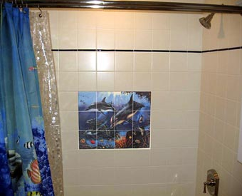 Dolphin tile mural for the shower wall.  This colorful dolphin mural looks great in the bathroom.