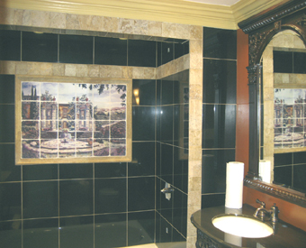 This tuscan scene mural  is PERFECT for this bathroom. The black tiles that surround the tile mural really make it