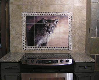 Kitchen Backsplash Tile Mural Intensity Item 15-091. This beautiful tile mural of a Jaguar is stunning. Kitchen backsplashes don't always have to be of fruit or vegetable tiles. This customer used an interesting border to frame out their tile mural. Awesome!