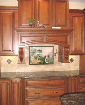 This old world  master artwork works perfectly with the stunning cabinetry and gorgeous granite countertops. Setting the field tiles on the diamond is a great way to really bring out the mural. Consider this great kitchen  tile backsplash idea when designing your kitchen!