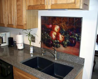 Tile murals with fruit can transform a kitchen remodelling project.  Lots of apples, grapes and plums.