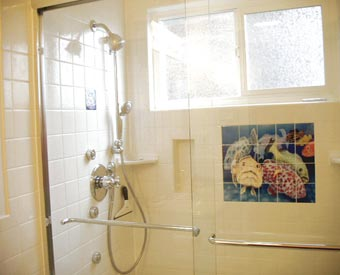 This grouper fish tile mural is made on ceramic tile certainly makes taking a shower in this bathroom more fun.