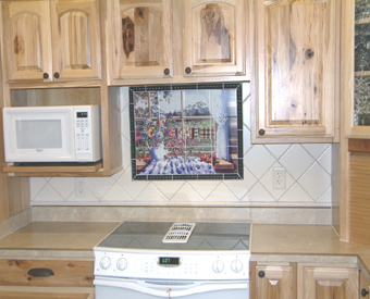 If your kitchen doesn't have a  window just add a tile mural like this one and give the illusion of a window with a beautiful outdoor view. This colorful tile mural add